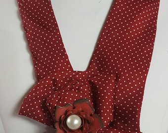Women's necktie made from using a repurposed necktie. Necktie jewelry made from an upcycled necktie.