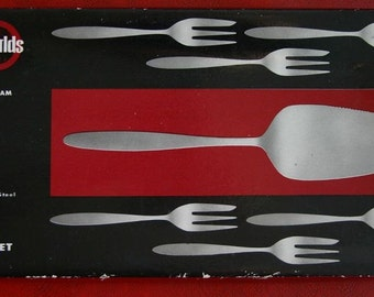 Two Worlds solid stainles steel seven piece party set by Monogram Sheffield