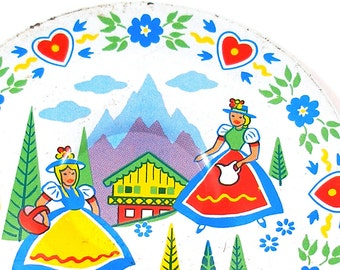 50's tin toy tea plate, Alpine Maids graphics, small size.