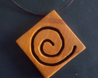 Necklace with Celtic spiral pendant on wood