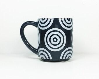15oz coffee mug/tea mug with White Bullseyes all over, shown here in Blackest Black glaze. Made to Order.