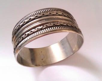 silver coloured metal bangle