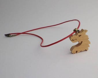 dragon in cherry wood and red leather pendant