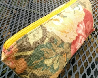 Pouch made with upholstery fabric remnants, floral print in green, red and gold