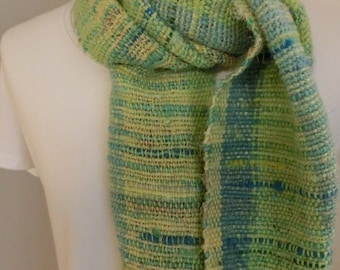 Handwoven scarf made from merino wool, recycled sari silk, silk strands and organic cotton.