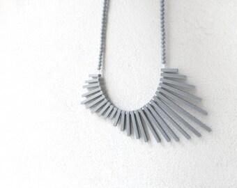 tribal geometric necklace , grey sticks and beads , contemporary jewelry