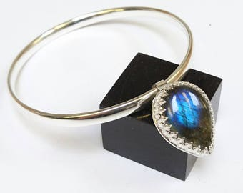 Sterling silver handmade oval bangle with pear shaped labradorite cabochaon charm, hallmarked in Edinburgh