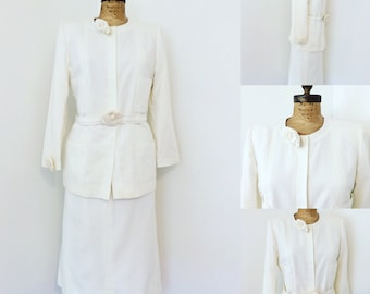 Chanel Skirt Suit Perforated white cotton, with classic Chanel flower. Stunning!!