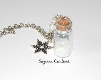 Long vial of snow, snowflake and frozen pearls