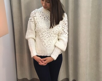 white pullover crocheted and knitted from a mixture of angora, mohair, other