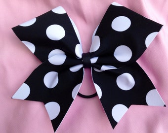 Cheer bow- black with white dots.