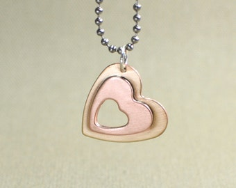 Double Heart Necklace in Copper and Bronze with Heart Cut Out for Triple the Love - NL516