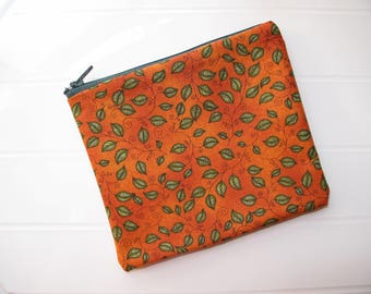Small orange Pouch Cosmetic Case with green leaves