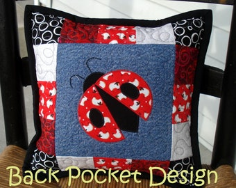 """Red Ladybug Quilted Denim 10"""" Toss Pillow made with recycled denim jeans"""