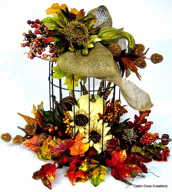 Items similar to fall birdcage floral arrangement