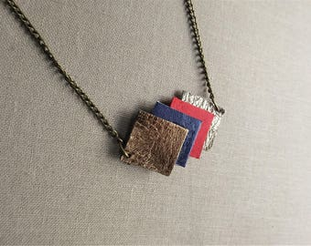 Necklace brass and leather, bronze, dark blue, carmine red and gold metallic leather