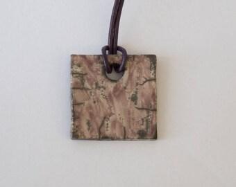 Ceramic square Raku color old pink pendant on leather cord