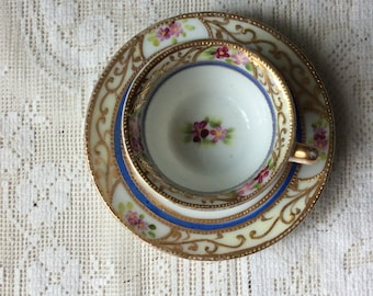 Vintage Miniature Tiny, Doll Tea cup and Saucer, Occupied Japan ,Hallmarked, Hand Painted, Raised Gold Guild