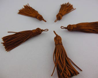 A caramel color rayon thread tassel