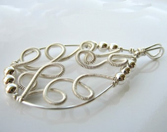 Heavenly swirls of sterling silver pendant