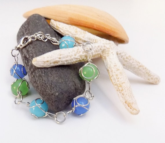 wire wrapped blue and green beaded bracelet