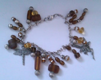 silver coloured charm bracelet with amber glass beads