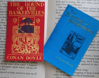 2 Arthur Conan Doyle bookmarks: The Adventures of Sherlock Holmes & The Hound of the Baskervilles, original book cover