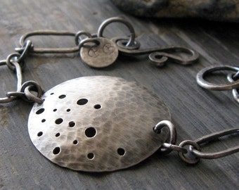 Sterling silver bracelet. Bold unique handmade jewelry. Rustic antique finish.  Large focal disc with dot pattern.  Gift for women.