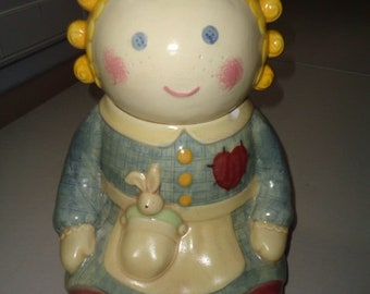 Charming Treasure Craft Spice Rag Doll Cookie Jar has a chip on collar