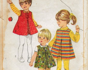 """An Inverted Pleat, Square Neck A-Line Jumper & Long/Short Sleeve Back Button Blouse Pattern for Toddlers: Size 1 Breast 20"""" •Simplicity 7334"""