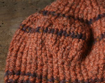 Cap in raw orange wool made at crochet