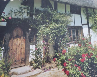 A vintage jigsaw of a classic thatched English cottage 1000 pieces 19 by 28 ins