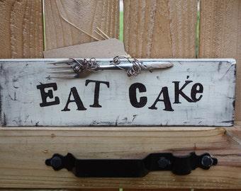 Eat cake sign with dessert fork!