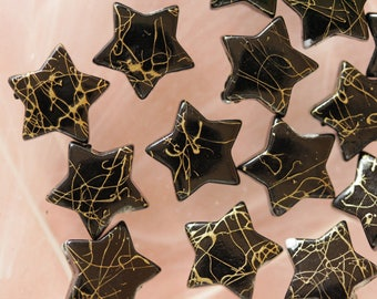 set of 10 beads black and golden stars