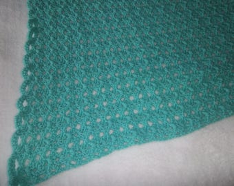 Teal lap blanket for seniors or others who love to sit with legs covered. Crochet lap blanket for older adults