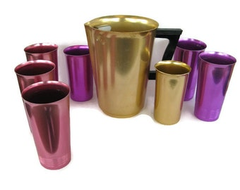 colorful aluminum tumblers and gold pitcher, Sunburst, West Bend, 1950's