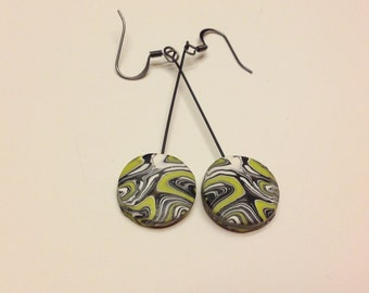 Playful pop art dangles in lime, white and black
