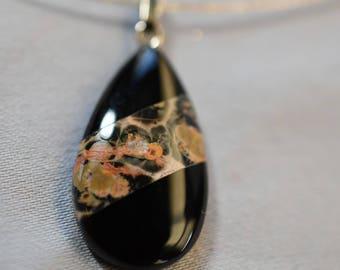 Teardrop stone look pendant on silver chain