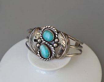 Authentic vintage Native American sterling silver bracelet decorated with turqoises.