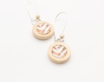 Round wooden earrings dangle . Earrings white and brown stripes . Earrings handmade out of wood and glass
