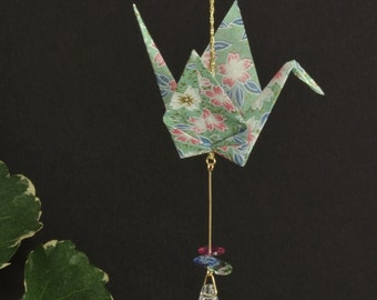 Origami Crane Suncatcher - light green paper with flowers, hand varnished, with brilliant Swarovski crystals