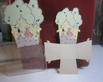 Art deco die cut 1920's-30's party favor nut cup candy cup stylized deco trees colonial man in powder wig and lady