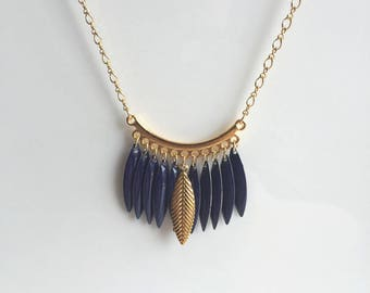 Gold necklace, marine blue navettes and golden leaf charm