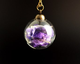 Purple flower necklace, Glass terrarium necklace, dried flowers, botanical petal pendant, botanical jewellery, minature glass ball bottle