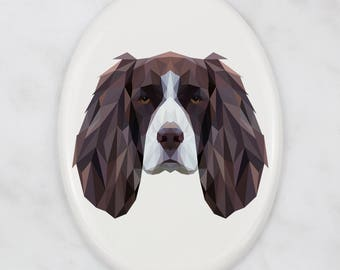 A ceramic tombstone plaque with a Springer Spaniel dog. Art-Dog geometric dog