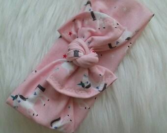 Stretchy top knot headband in unicorn print.