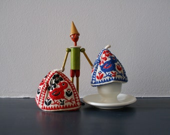 Egg warmers with cheerful motif
