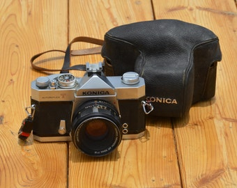 Vintage Konica Autoreflex T 35mm SLR film camera with 52mm f/1.8 Konica Hexanon AR prime lens and case