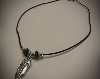 Dove feather pendant with beads