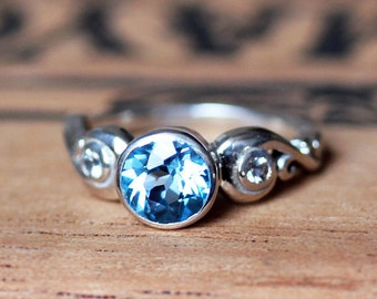 3 stone engagement ring, blue topaz engagement ring, alternative engagement ring, bezel engagement ring, three stone ring, Cumulus ring